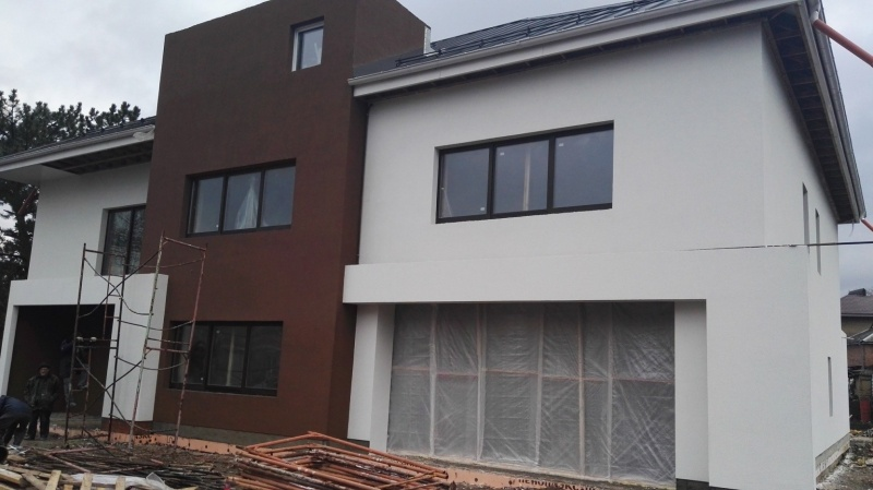 Штукатурка фасада, выравнивание стен фасада