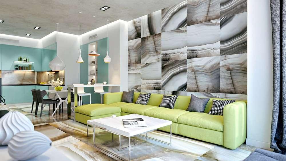 Отличный пример сочетания зеленого дивана и серого интерьера