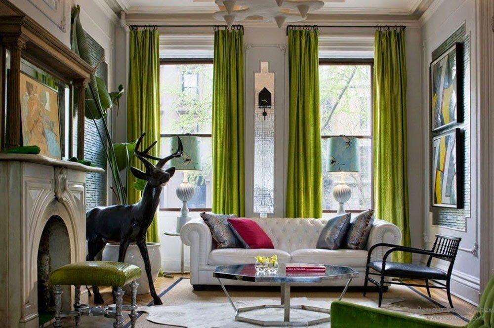 В интерьере в эко стиле уместны зеленые шторы
