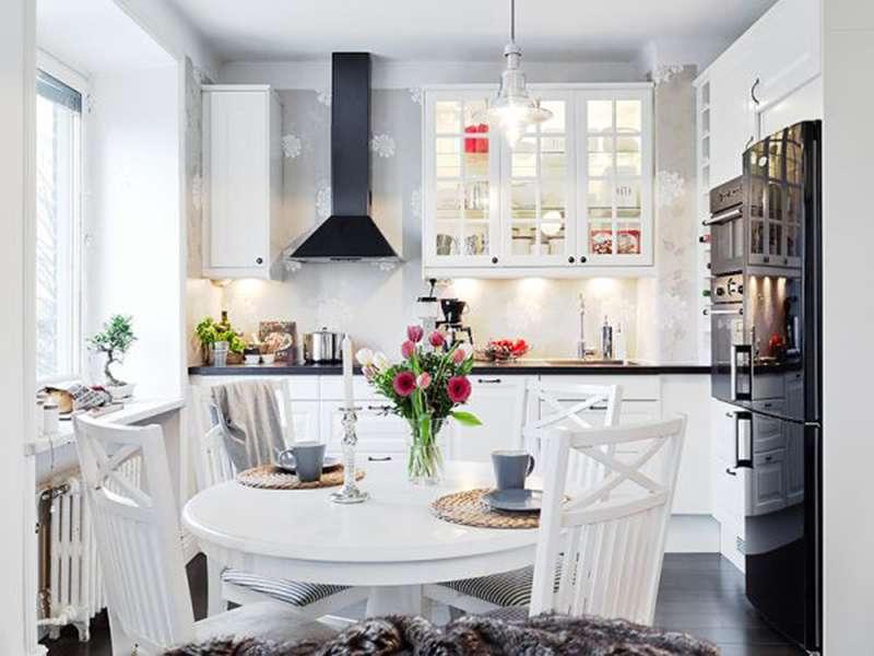 Деревянная мебель в интерьере кухни в скандинавском стиле