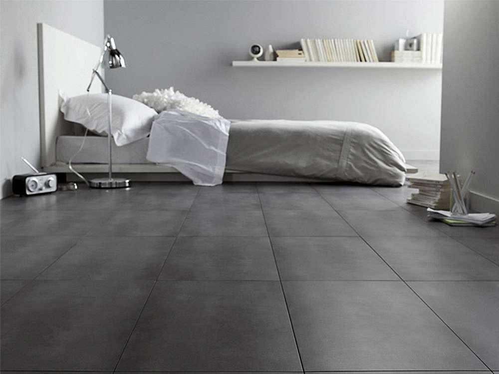 Темно-серый пол в интерьере спальни в стиле минимализм