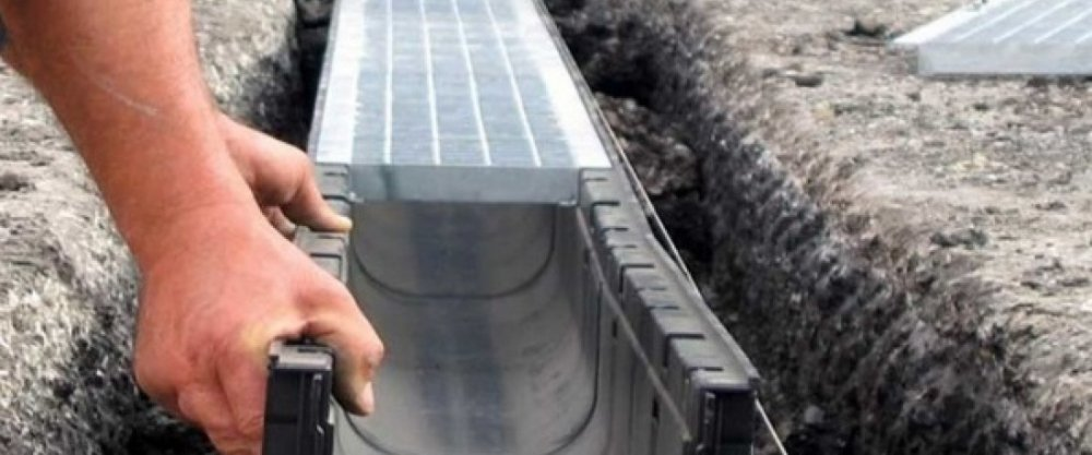 Система отвода атмосферных осадков с участка (ливневая канализация)